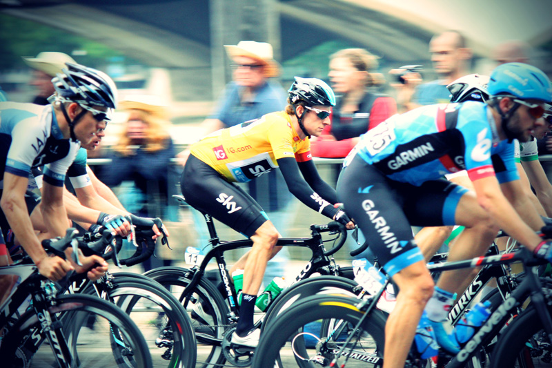 Cyclists in a race. Laser hair removal for men can help give them a competitive edge.